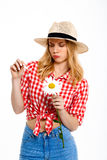 Portrait of beautiful country girl with chamomile over white background. Stock Images