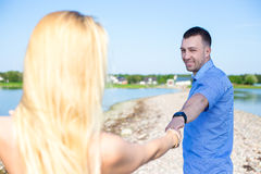 Portrait of beautiful couple in love walking on summer beach Stock Images