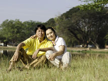 Beautiful couple sitting in park Royalty Free Stock Image
