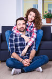 Portrait of beautiful couple sitting on sofa Royalty Free Stock Images