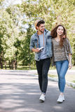 Portrait of a beautiful couple walking in park Stock Image