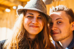 Portrait of a beautiful couple walking in the street in summer, they wear  hat Royalty Free Stock Images