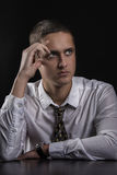 Concentrated thinking young man Stock Image