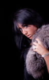 Portrait of a beautiful curious brunette. Portrait of a attractive sexy girl with coat and bracelet Royalty Free Stock Images