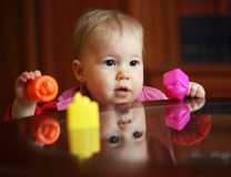 Portrait of beautiful cute child with toys Stock Image