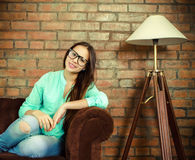 Portrait of a beautiful cute teen girl in the living room Royalty Free Stock Image