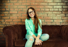 Portrait of a beautiful cute teen girl in the living room Stock Photo
