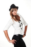 Portrait of beautiful dancing girl in hat. Portrait of beautiful dancing girl in dark hat royalty free stock photography
