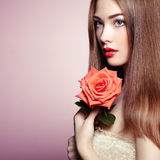 Portrait of beautiful dark-haired woman with flowers Royalty Free Stock Images