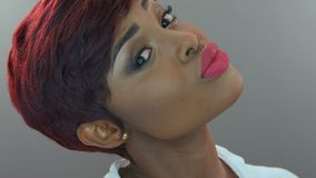 A portrait of a beautiful dark-skinned woman stock footage