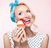 Portrait of beautiful delicate blonde woman with sweets Stock Photos
