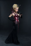 Portrait of beautiful devil woman in dark dress Royalty Free Stock Photos