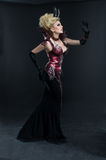 Portrait of beautiful devil woman in dark dress royalty free stock images