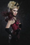 Portrait of beautiful devil woman in dark sexy dress Royalty Free Stock Photos