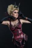 Portrait of beautiful devil woman in dark sexy dress Stock Photo