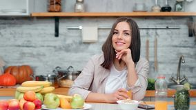 Portrait of beautiful dieting woman during breakfast at cosiness cuisine interior