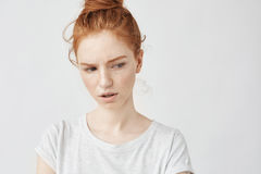 Portrait of beautiful dissatisfied redhead girl with freckles. Royalty Free Stock Image