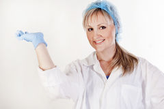 Portrait of beautiful doctor holding something in hand Royalty Free Stock Image