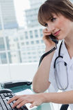 Portrait of a beautiful doctor on the phone Royalty Free Stock Photography