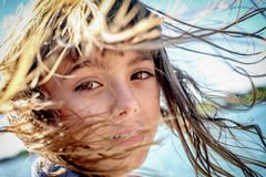 Portrait of a beautiful eight year old girl with the wind blowin Stock Photography