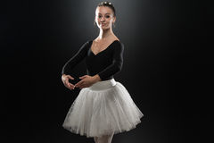 Portrait Of Beautiful Elegant Ballerina On Black Background Stock Photo