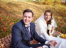 Portrait of a beautiful elegant newly married happy couple sitti Stock Photos