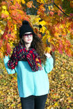 Portrait of a beautiful elegant woman in autumnal park Stock Photos