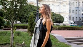Portrait of beautiful elegant woman in dress walking in park. Beautiful elegant woman in dress walking in park Royalty Free Stock Images