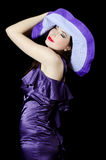 Portrait of the beautiful elegant woman in a lilac hat Royalty Free Stock Images