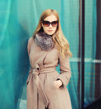 Portrait beautiful elegant woman wearing a coat jacket and sunglasses. In city Royalty Free Stock Photography