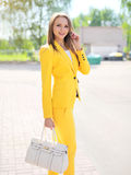 Portrait of beautiful elegant woman in yellow suit clothes Royalty Free Stock Images