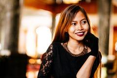 Portrait of beautiful elegant young lady smiling. Portrait of beautiful elegant young lady with nice background light Stock Image