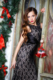 Portrait of beautiful elegant young woman in gorgeous evening dress over christmas background Stock Photography