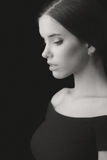Portrait of beautiful elegant young woman isolated on black back Stock Images