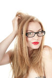 Portrait of beautiful embarrassed  girl in glasses. Royalty Free Stock Images