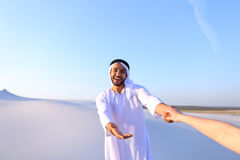 Portrait of beautiful Emirate male tourist guide, who holds woma Stock Photos