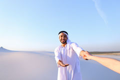 Portrait of beautiful Emirate male tourist guide, who holds woma Royalty Free Stock Images
