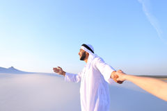 Portrait of beautiful Emirate male tourist guide, who holds woma Stock Image