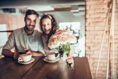 Portrait of beautiful emotional woman with bouquet flowers. Portrait of beautiful emotional women with bouquet flowers. Her husband holding hand when they climb royalty free stock image