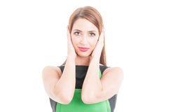 Portrait of beautiful employee covering ears Royalty Free Stock Photos