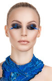 Portrait of a beautiful evening makeup. Blue eyelashes. The girl blue neckerchief Stock Images