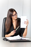 Portrait of a beautiful executive woman secretary at work while Stock Photography