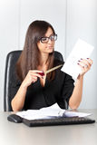 Portrait of a beautiful executive woman secretary at work while Stock Images