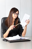 Portrait of a beautiful executive woman secretary at work while Royalty Free Stock Photography