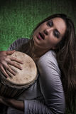 Beautiful sexy woman playing djembe drum Stock Photos