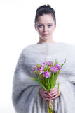 Portrait of beauty young woman with bunch of spring flowers Royalty Free Stock Photography
