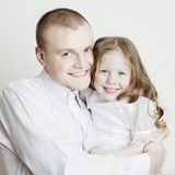 Portrait of beautiful family: father and daughter Stock Images