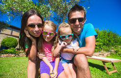Portrait of beautiful family of four on tropical Stock Image