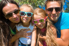 Portrait of beautiful family of four on tropical Stock Photo