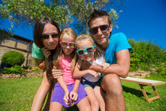 Portrait of beautiful family of four on tropical Stock Images